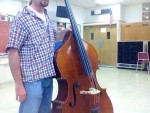 Standing versus sitting for the double bassist