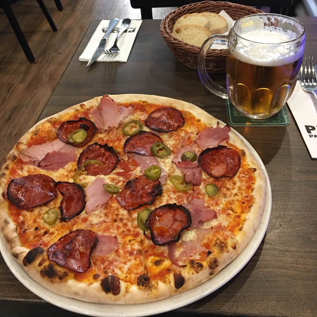 This pizza and beer cost less than $5. I love Prague!